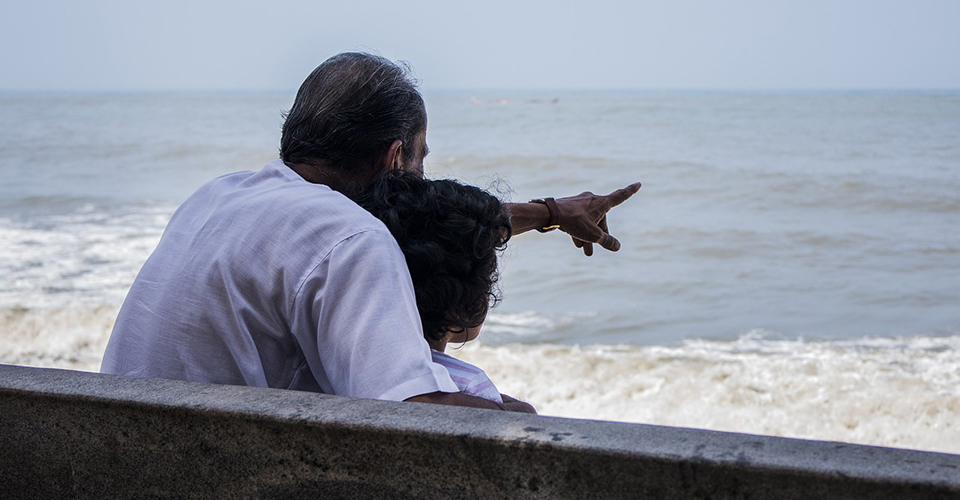 grandfather pointing into sea
